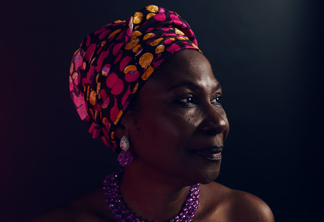my mom just came to America from Nigeria. she makes jewelry so i wanted to capture her with some of her work on