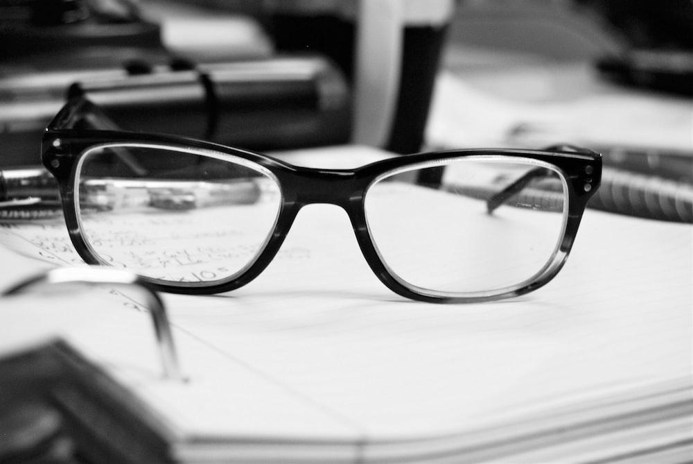 close up photo of black framed eyeglasses