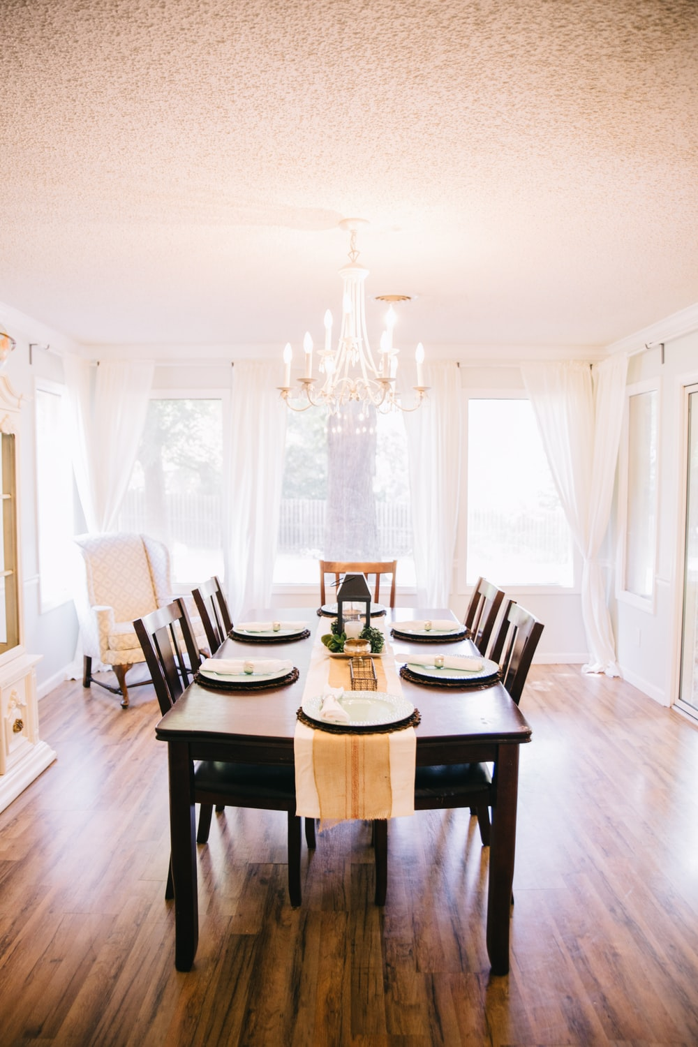 Rectangular Brown Wooden Table With Tabled Near Window