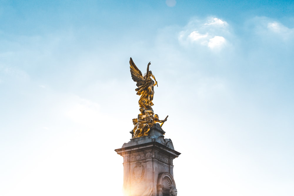 gold angel statue under blue sky