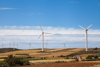 white windmills under blue sky during daytime tunisia zoom background