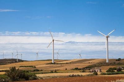 white windmills under blue sky during daytime tunisia teams background