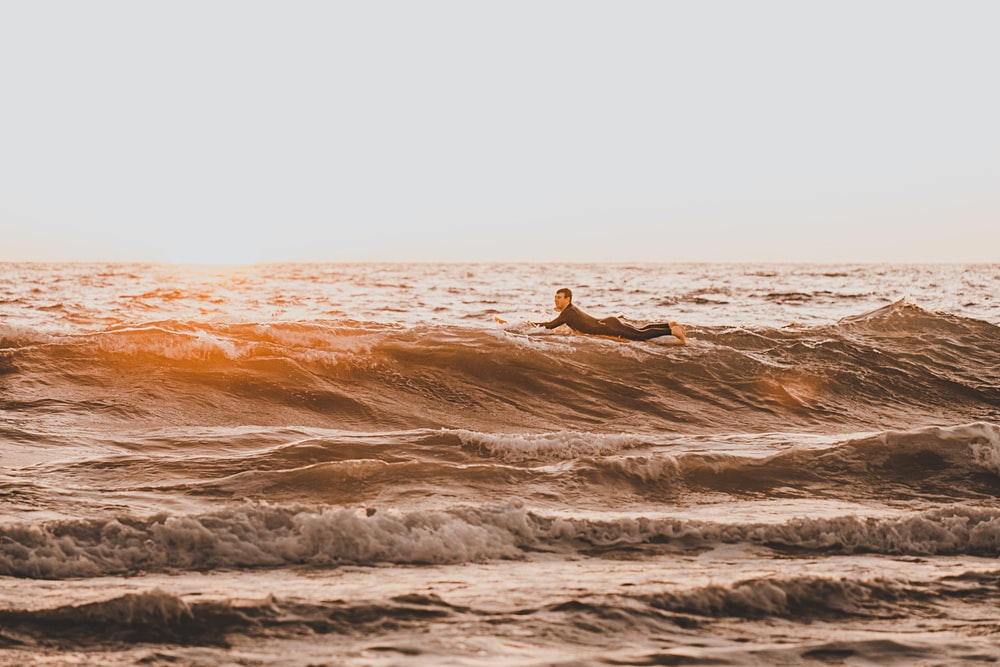 person surfing on water waves