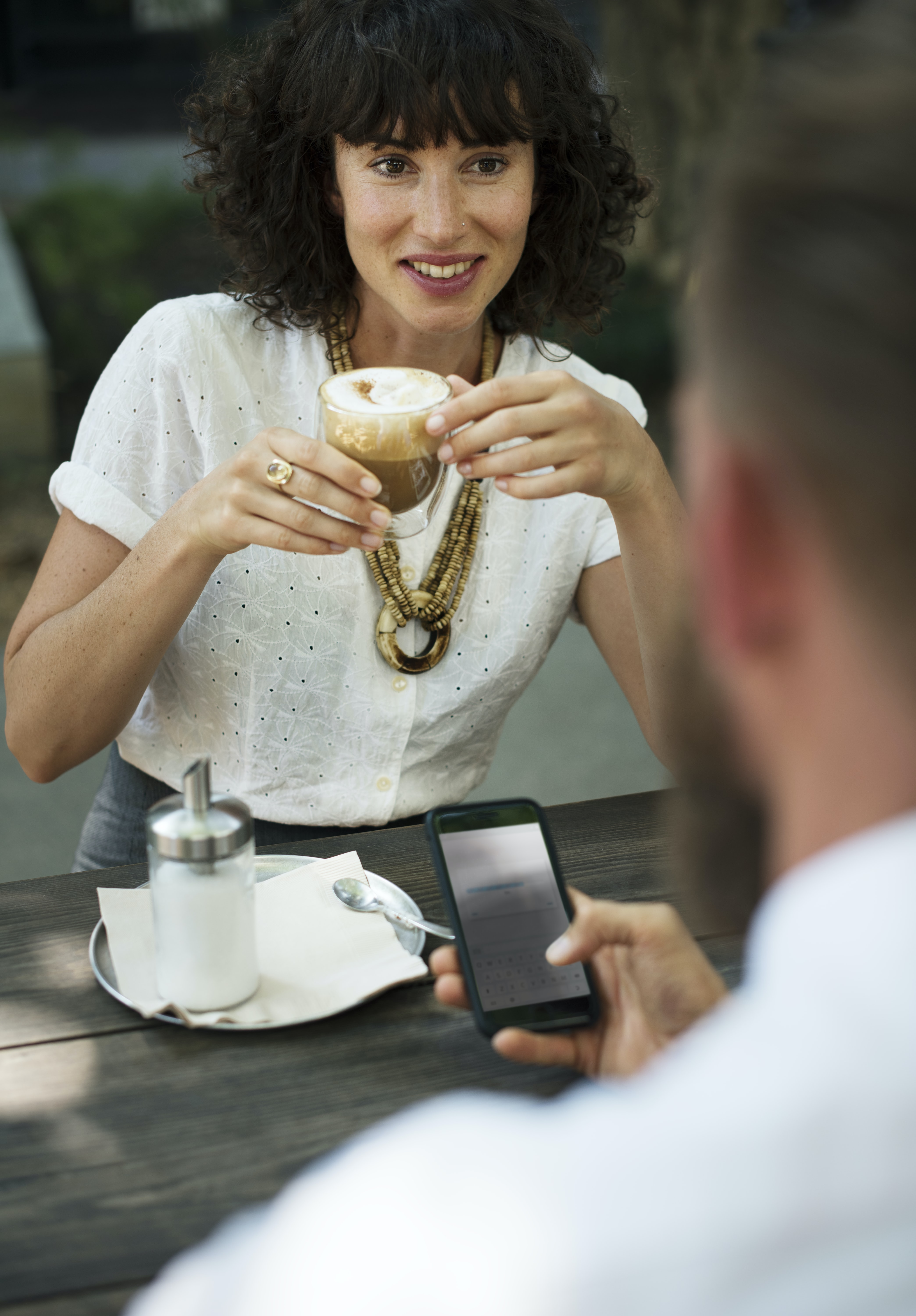 woman holding clear glass mug with beverage