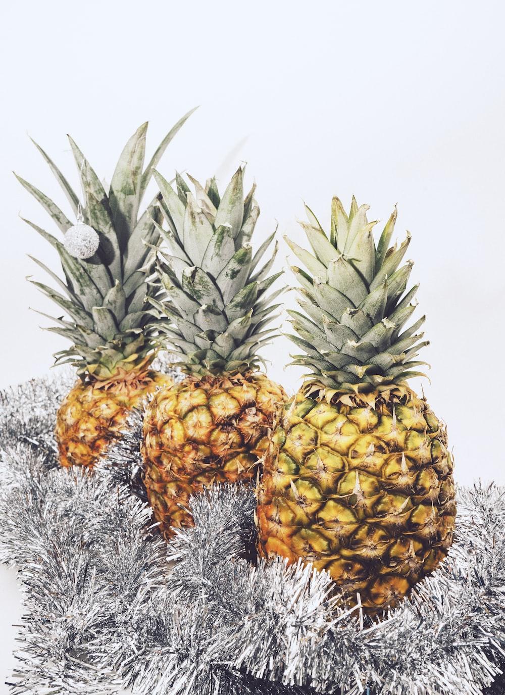 three yellow pineapple fruits