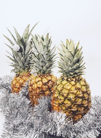 three yellow pineapple fruits