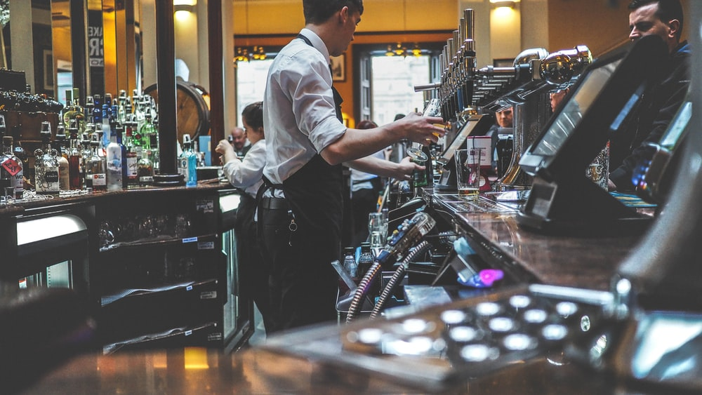 man preparing beverage drink in bar