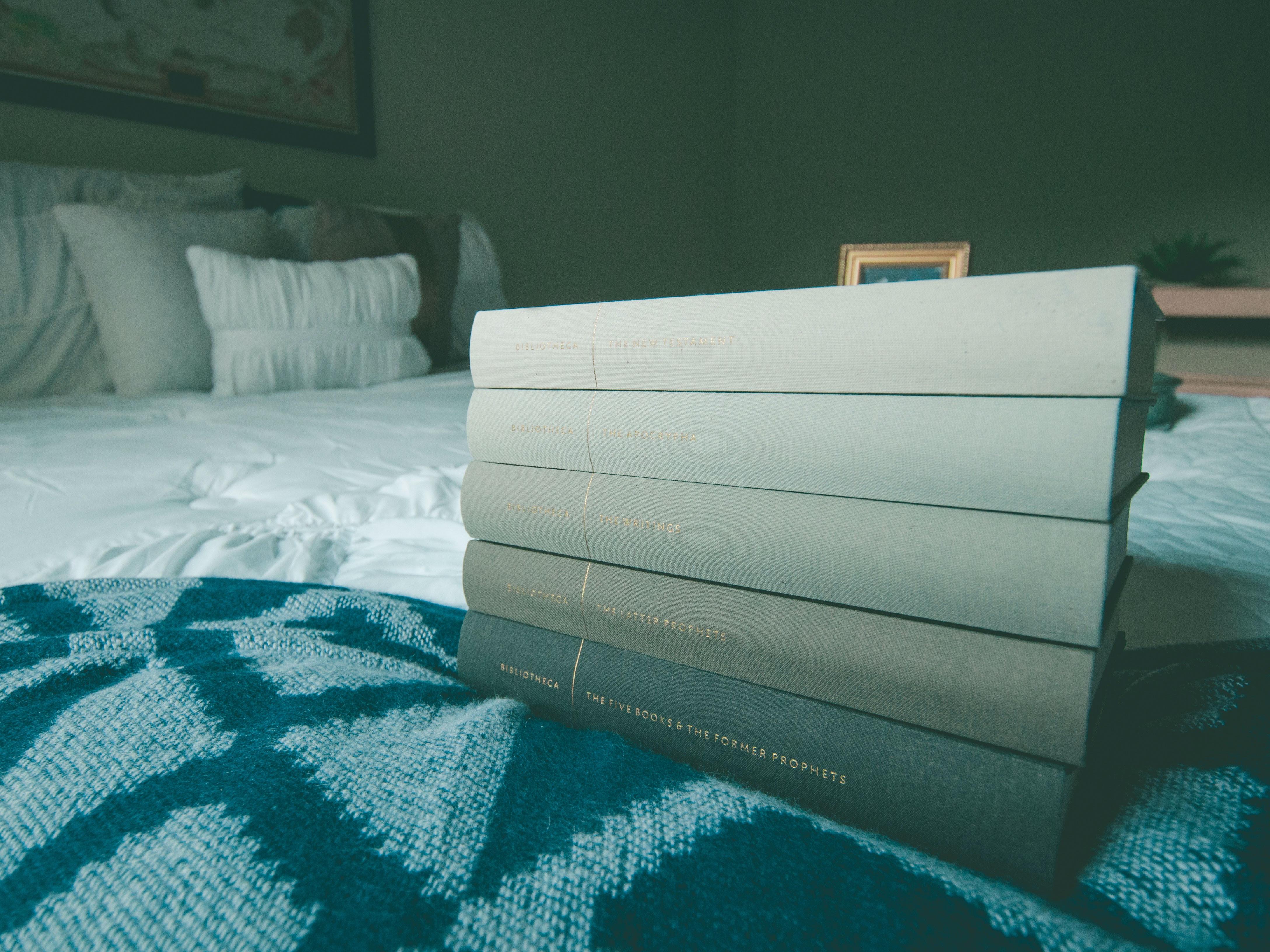several books on blue bed comforter