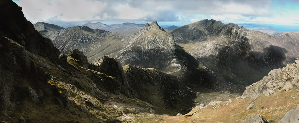 aerial photography of mountain under gray clouds