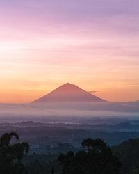 mountain under orange sky