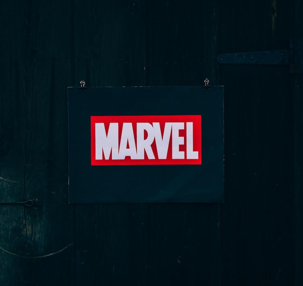 Marvel logo on black wooden board