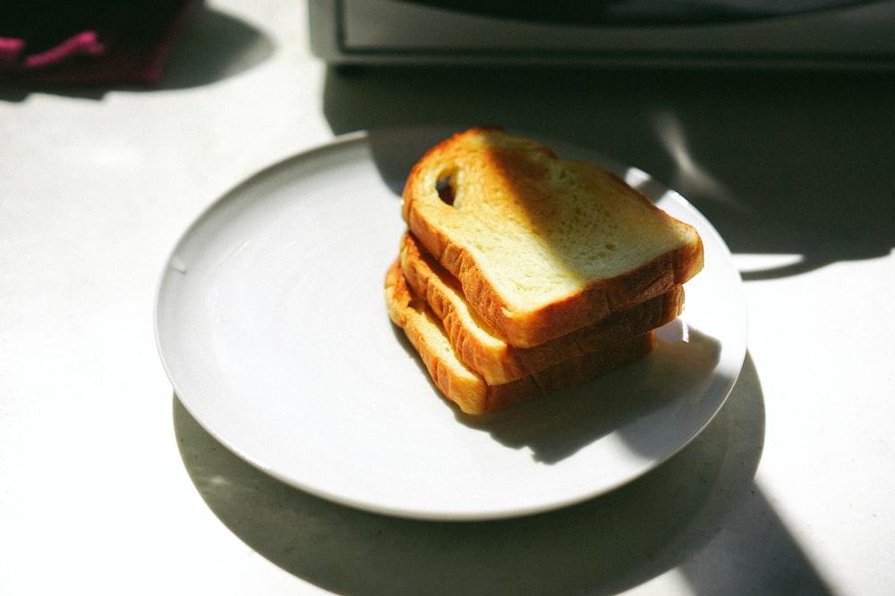 three sliced breads on white ceramic plate