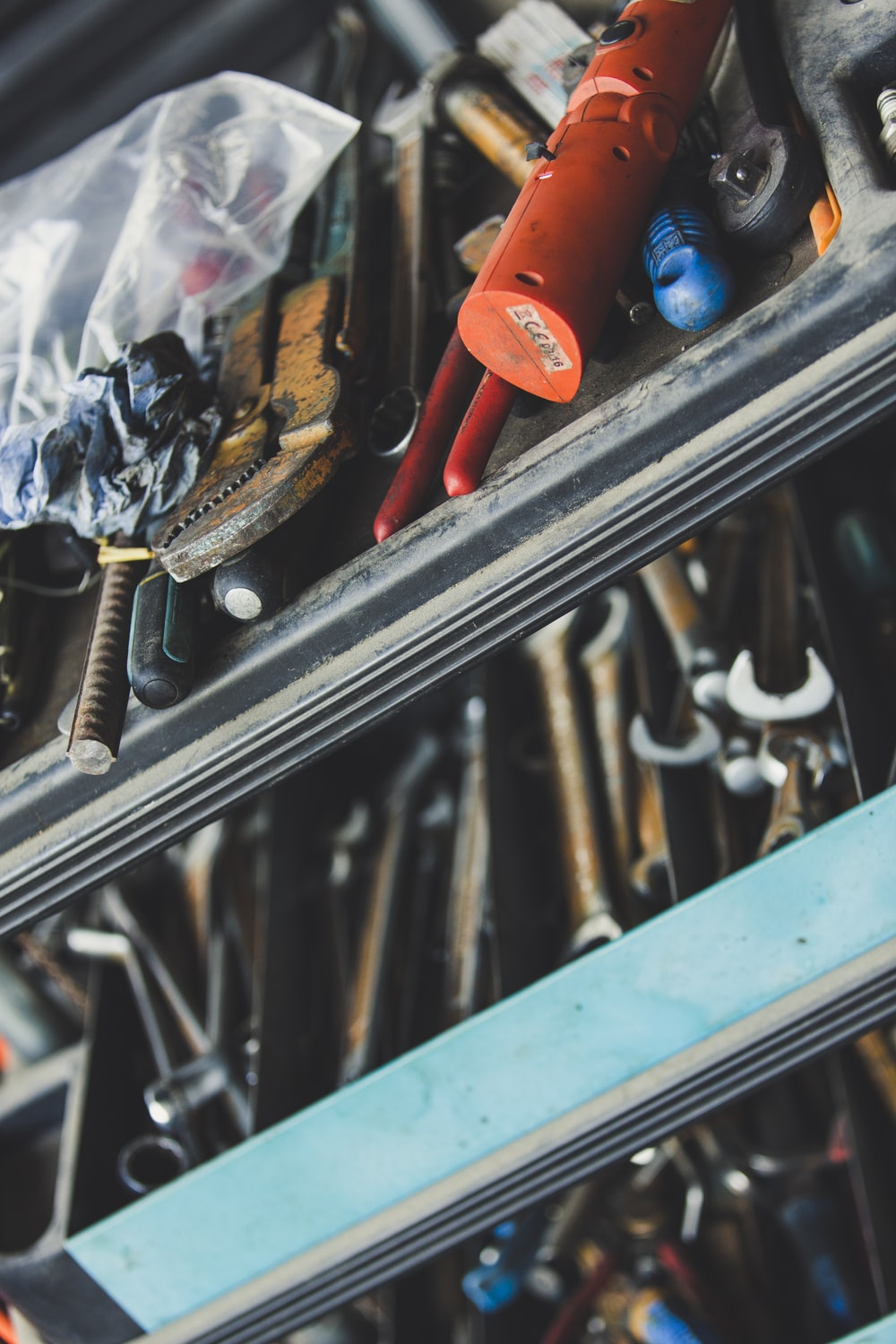 selective focus photography of tools in chest