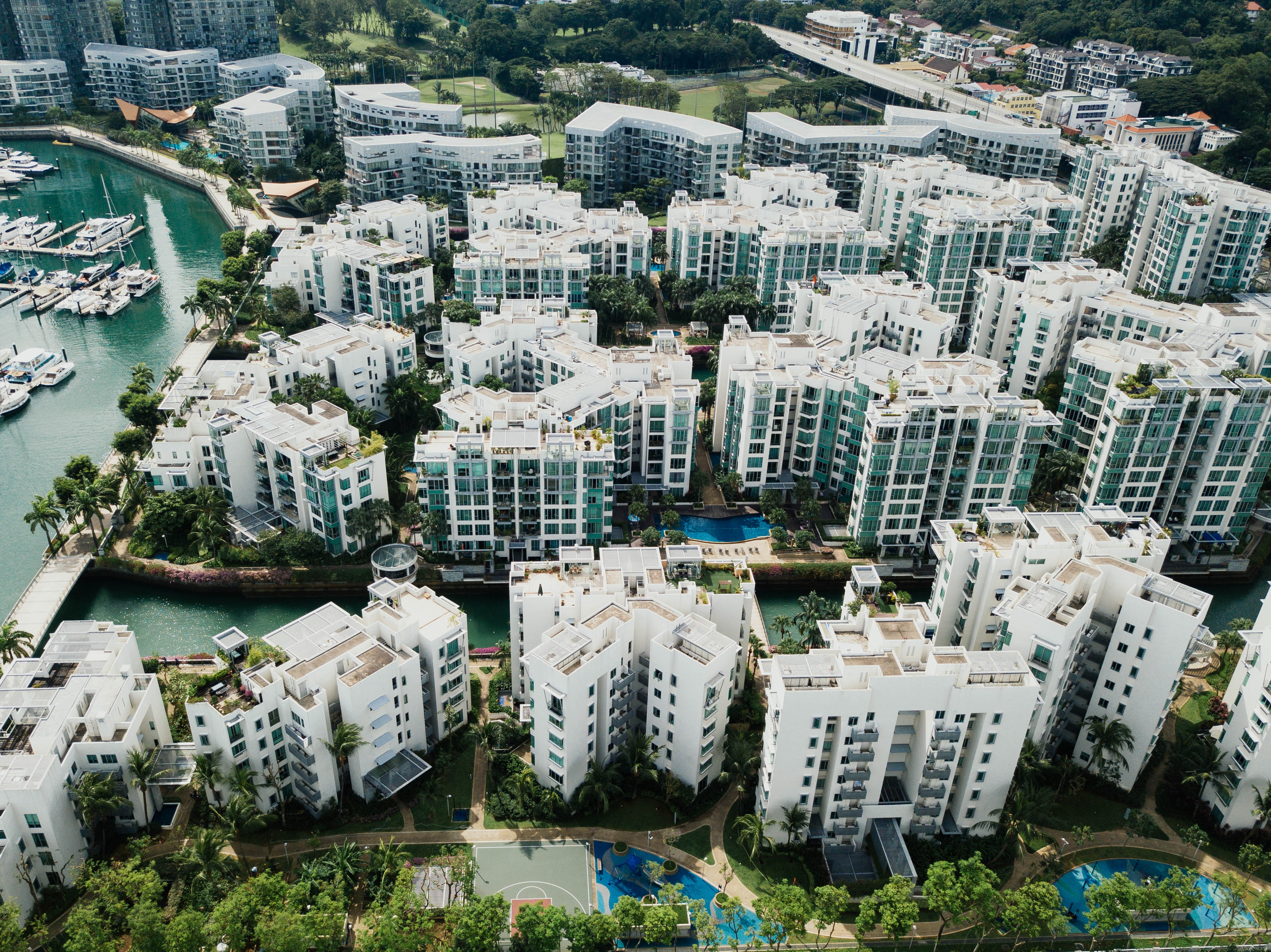 aerial photography of white concrete buildings beside body of water at daytime