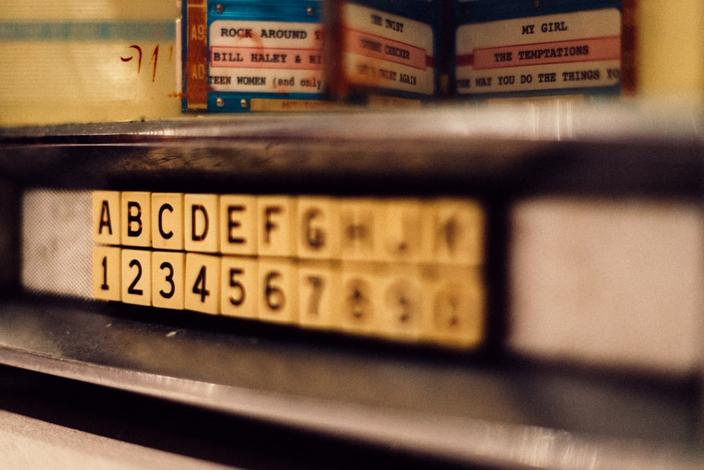 selective focus photo of alphabet and latter tile