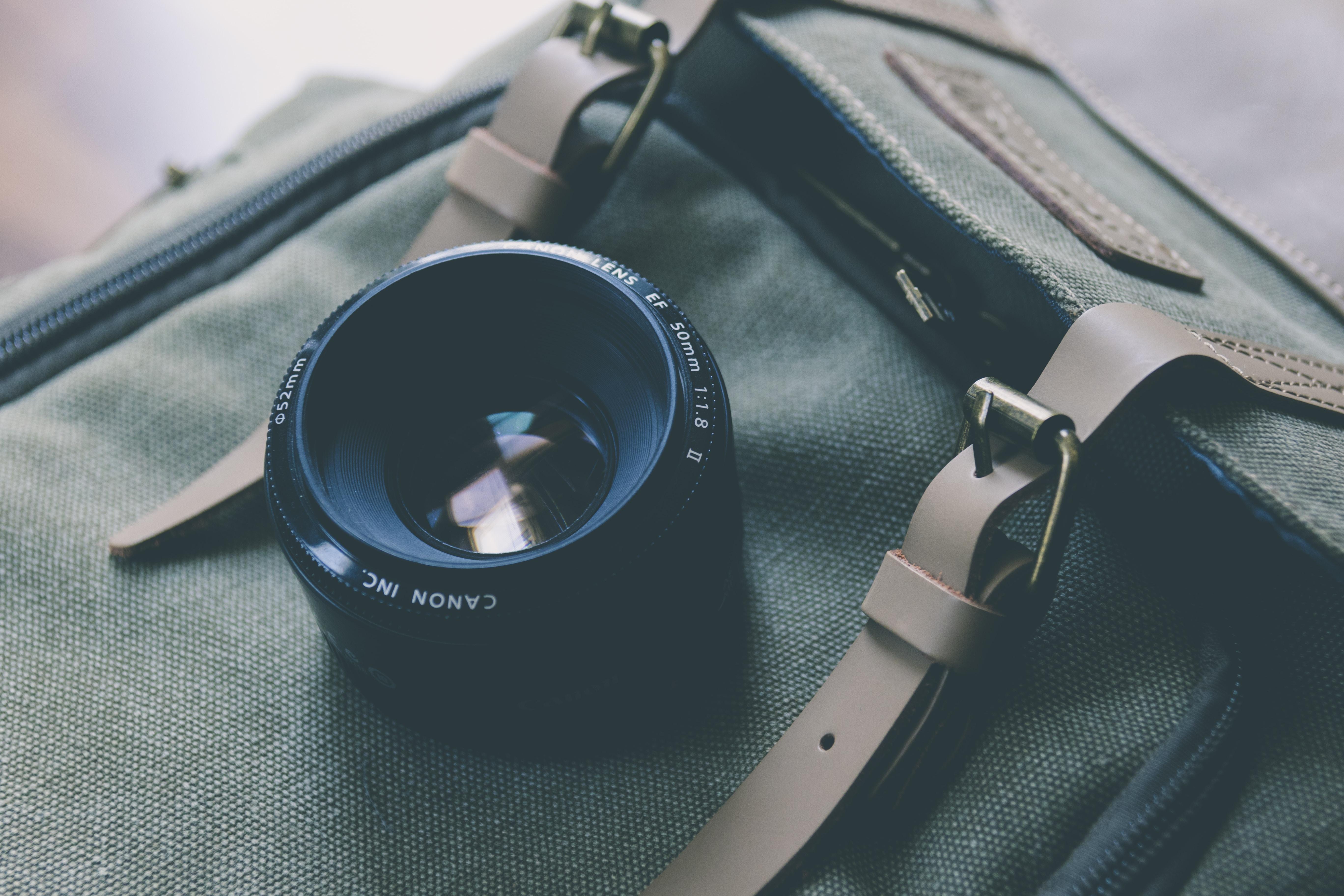 black camera lens on gray bag