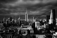 grayscale photo of high rise buildings