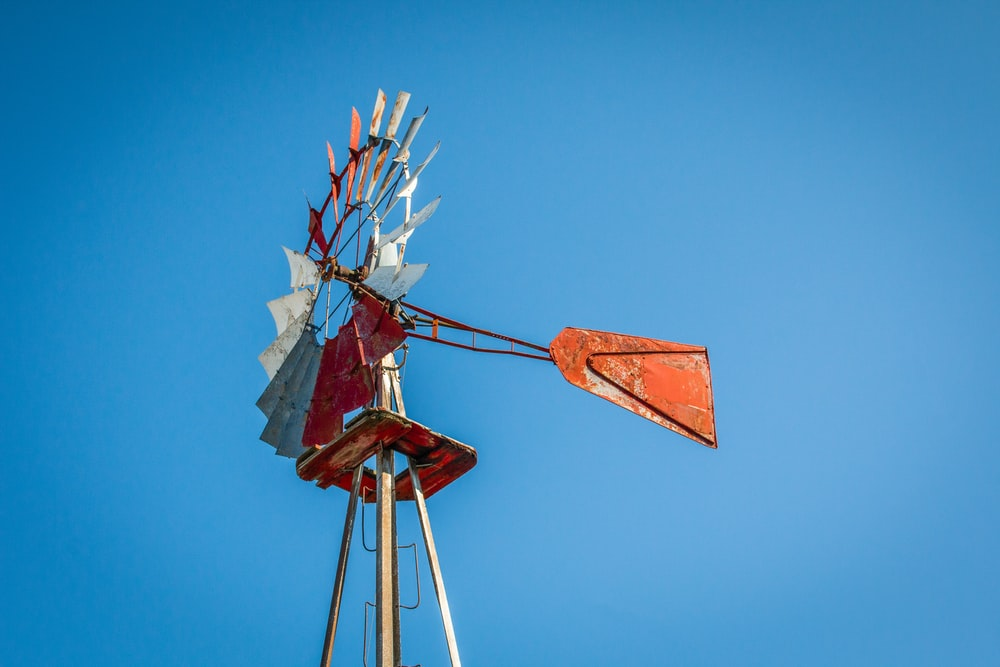 focus photo of brown windmill