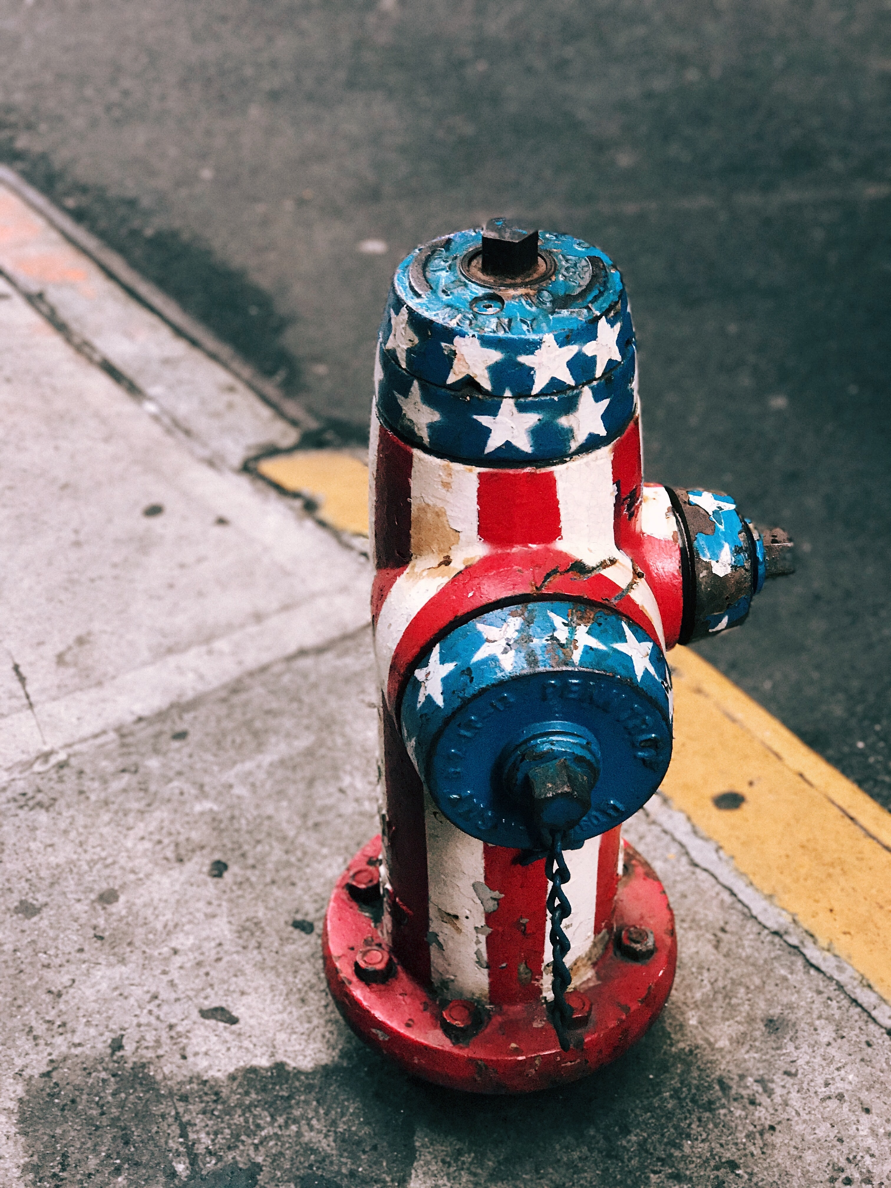 multicolored American flag painted fire hydrant at daytime