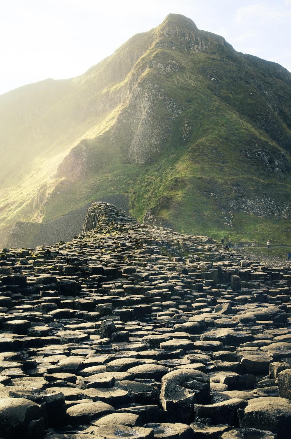 pile of rocks near on mountain