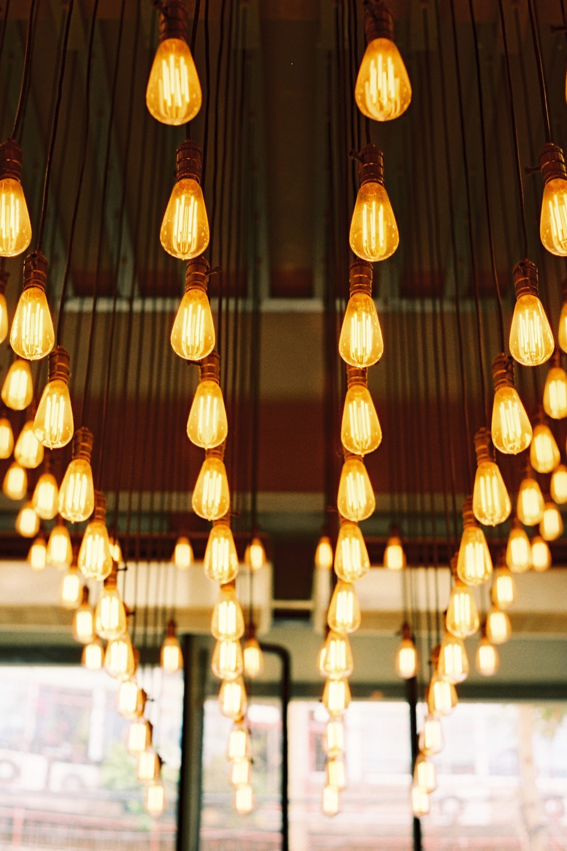 selective focus photography of light bulbs inside room
