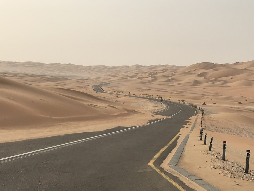 gray asphalt road on desert