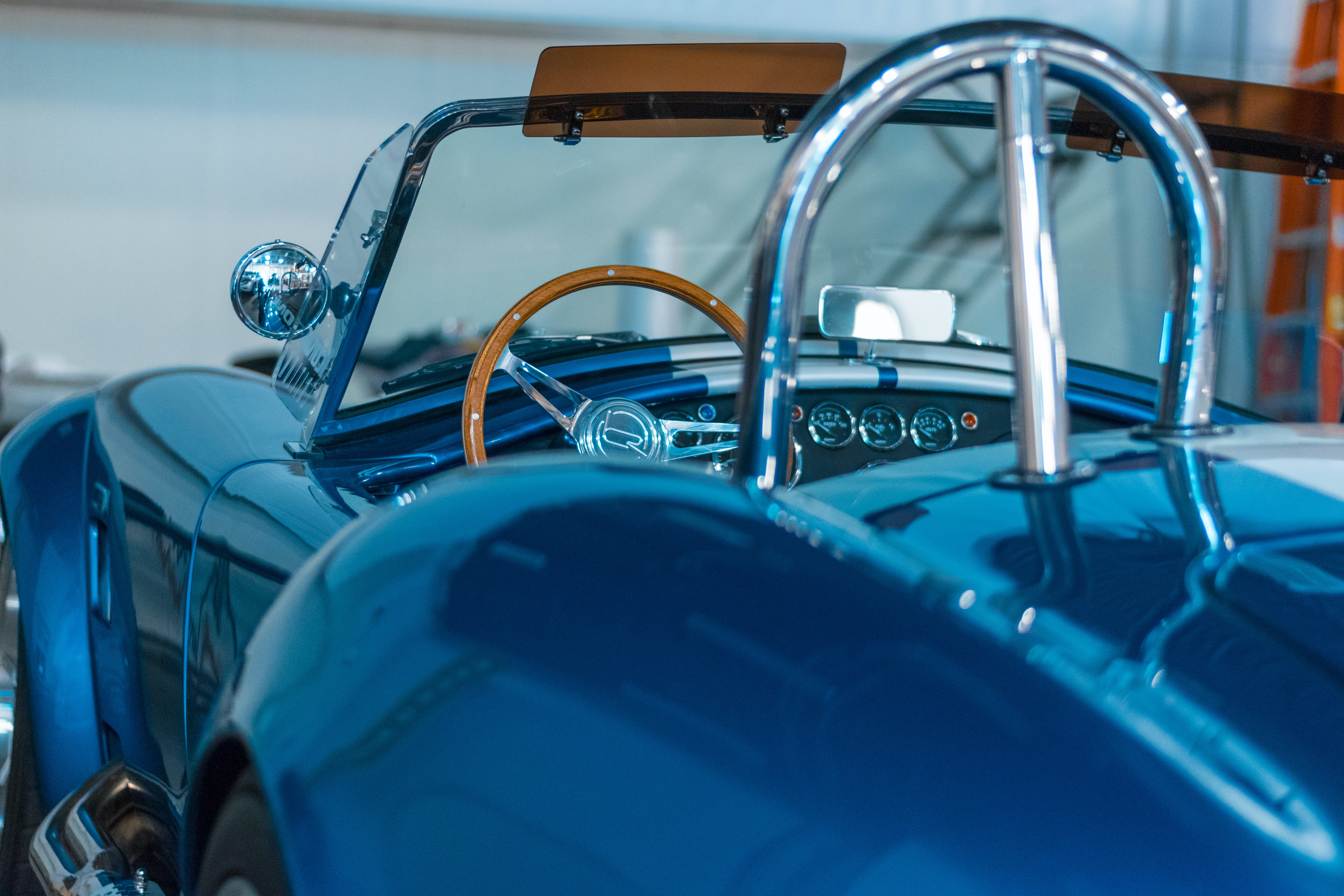 closeup photography of blue coupe at daytime