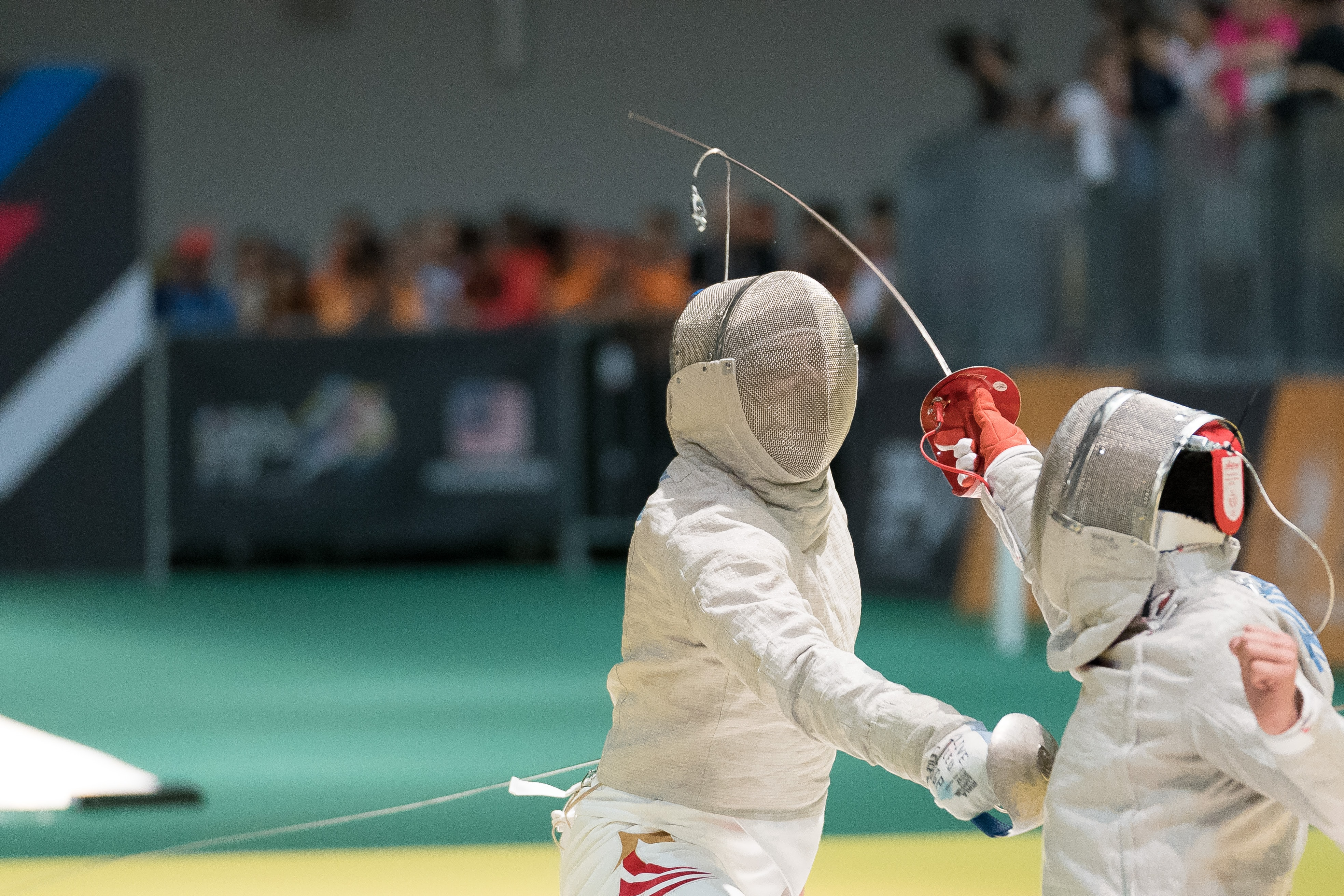 two person fencing inside the gym