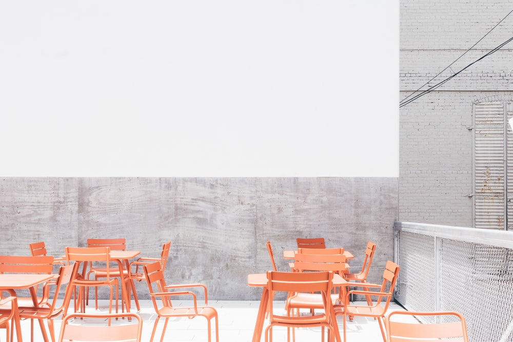 beige wooden table and chairs on rooftop during day
