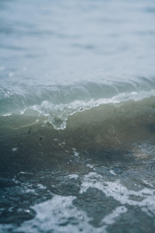 still life photography of seashore wave