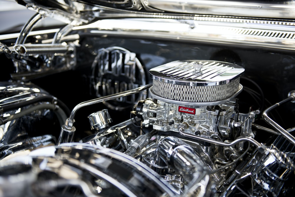 closeup photo of vehicle engine