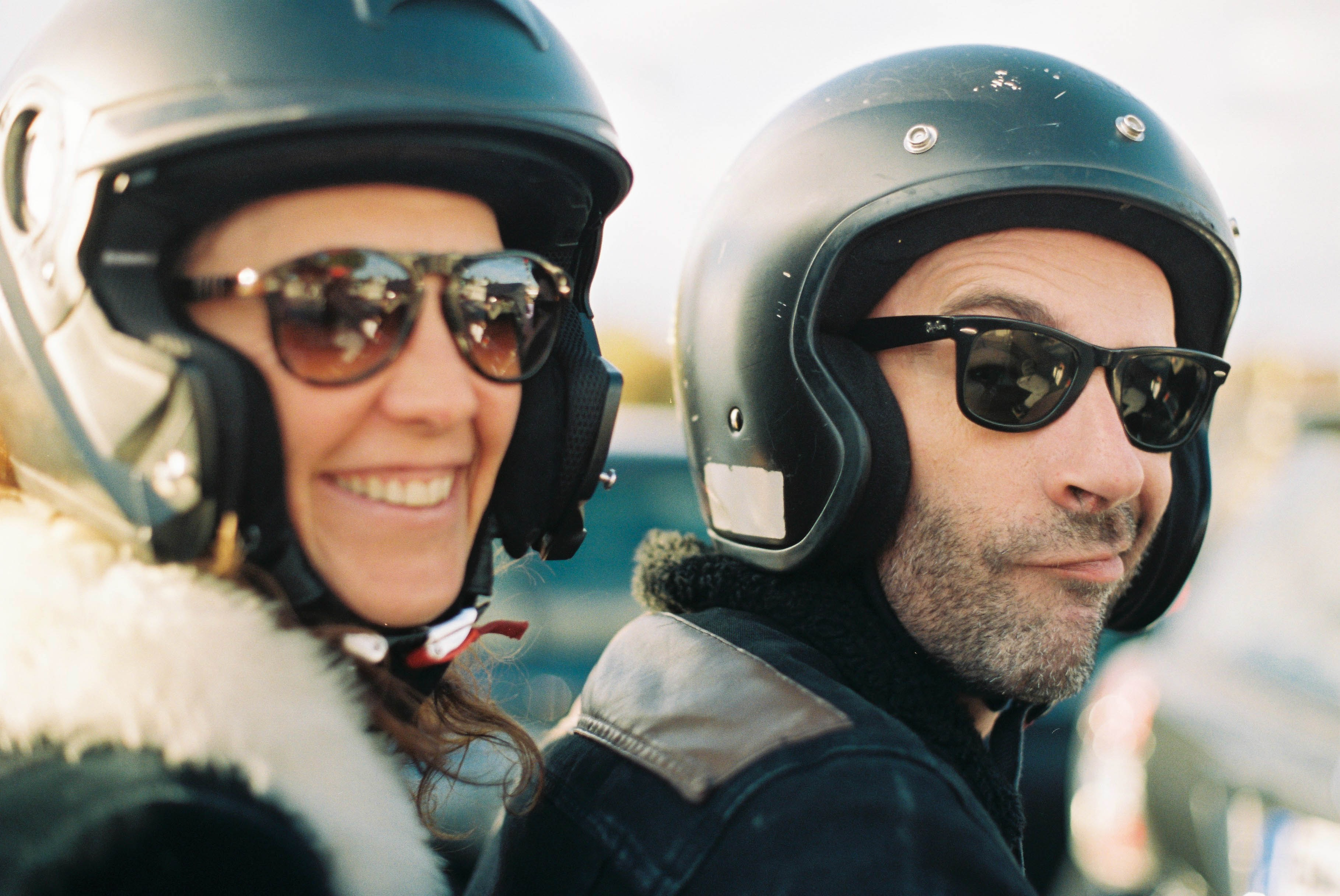 man and woman riding motorcycle