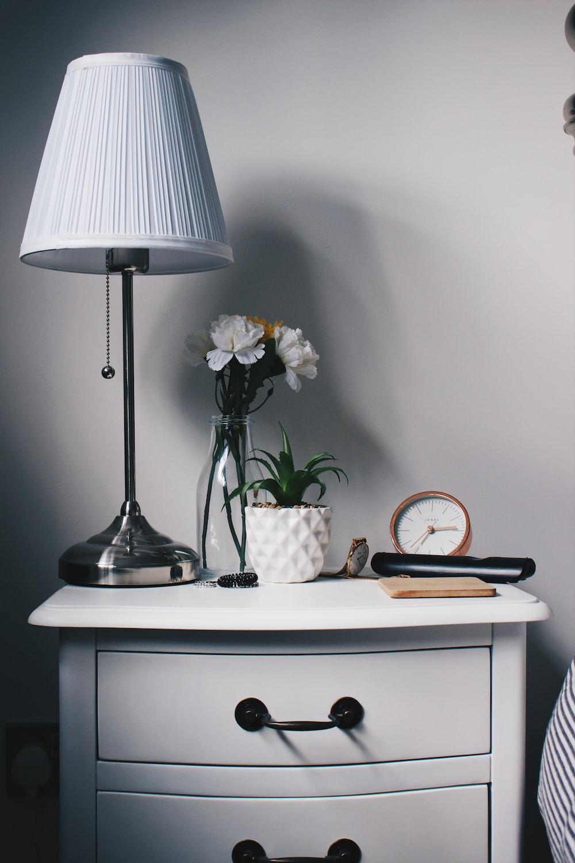 gray metal base white lampshade on nightstand