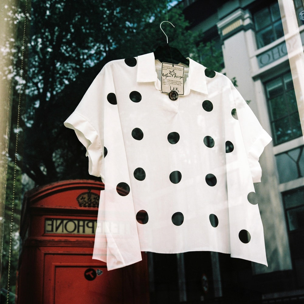 white and black polka-dot poncho top