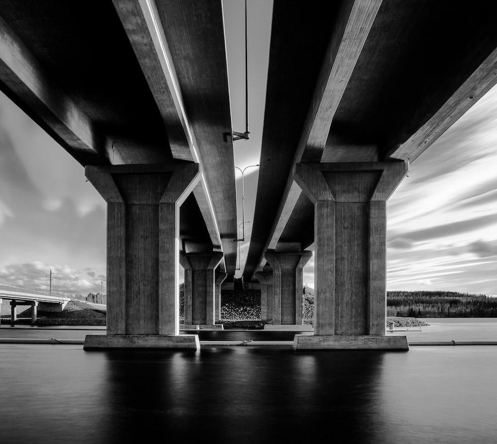 greyscale photography of concrete bridge