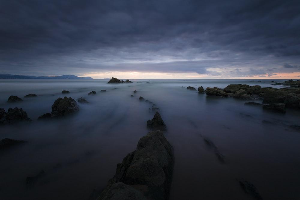 misty rock formation during daytime