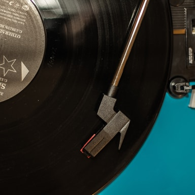 black vinyl record on turntable