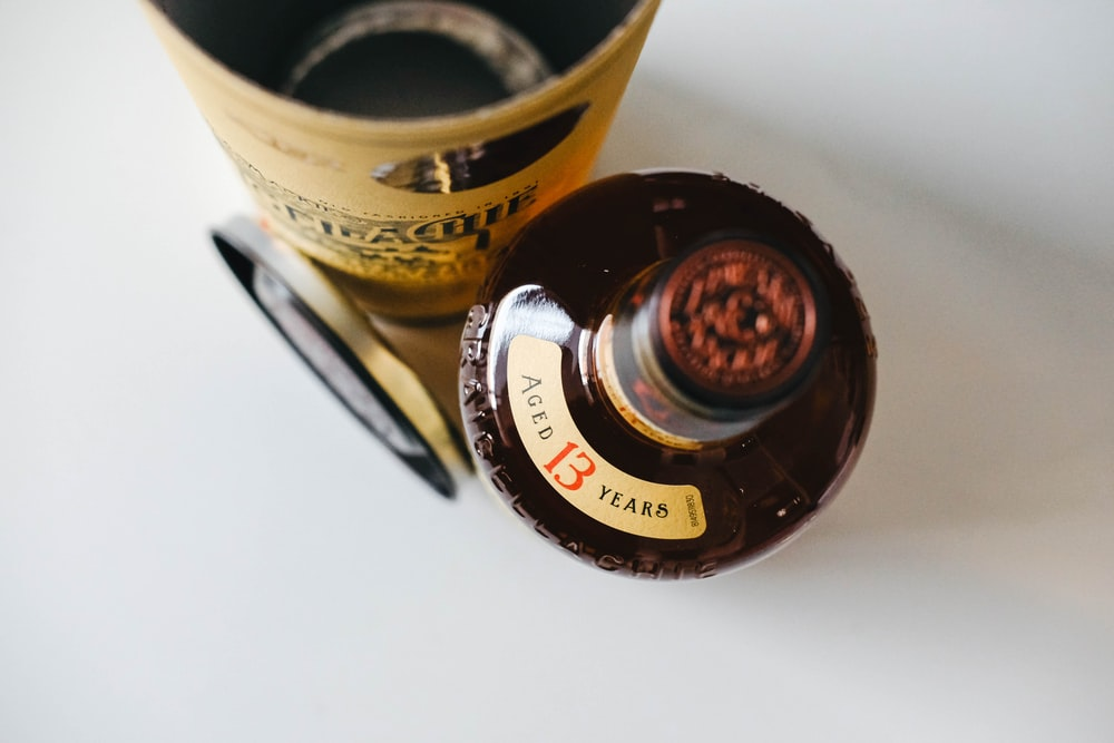 close-up photo of brown labeled bottle