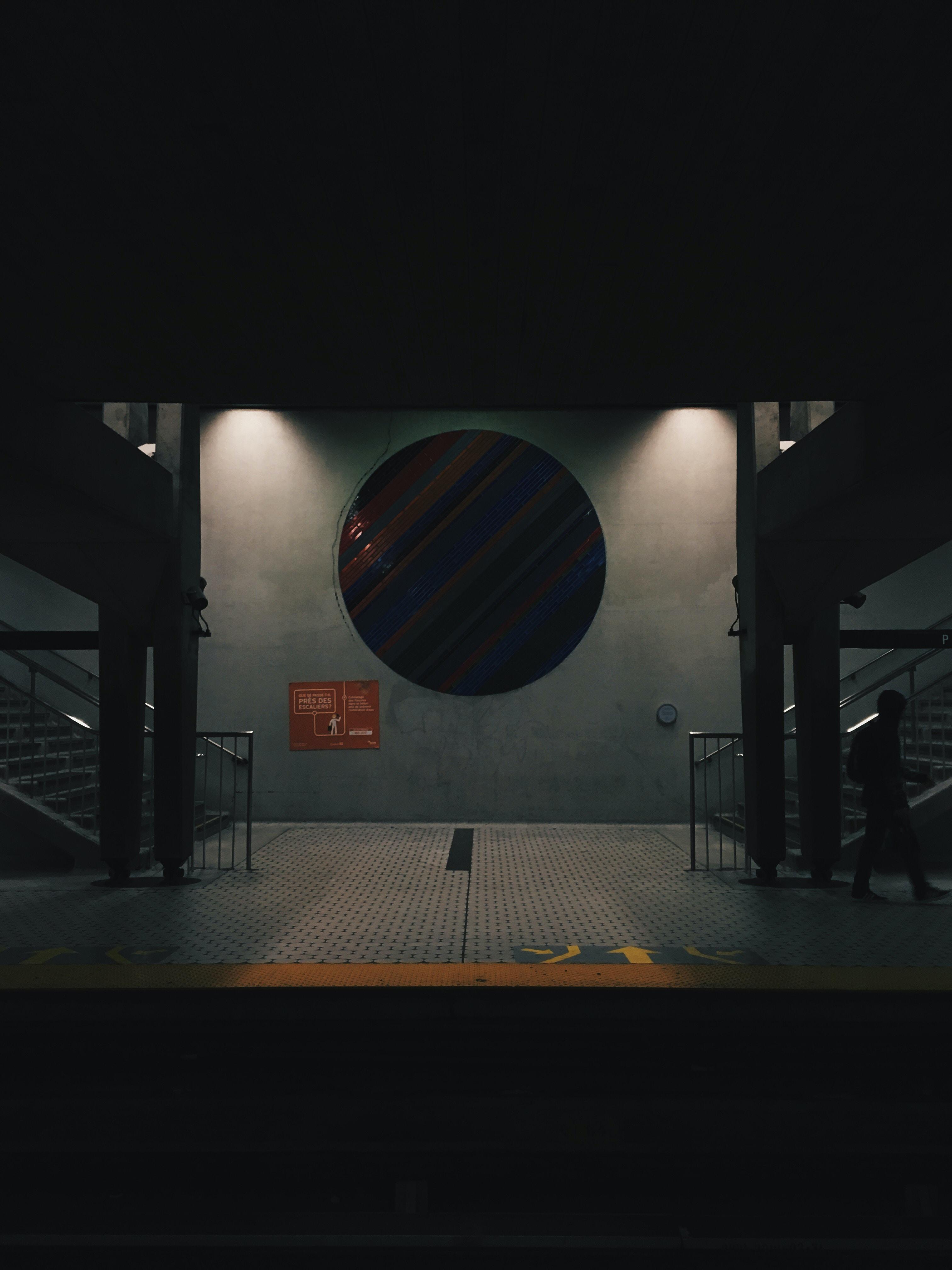 silhouette photo of man walking inside building