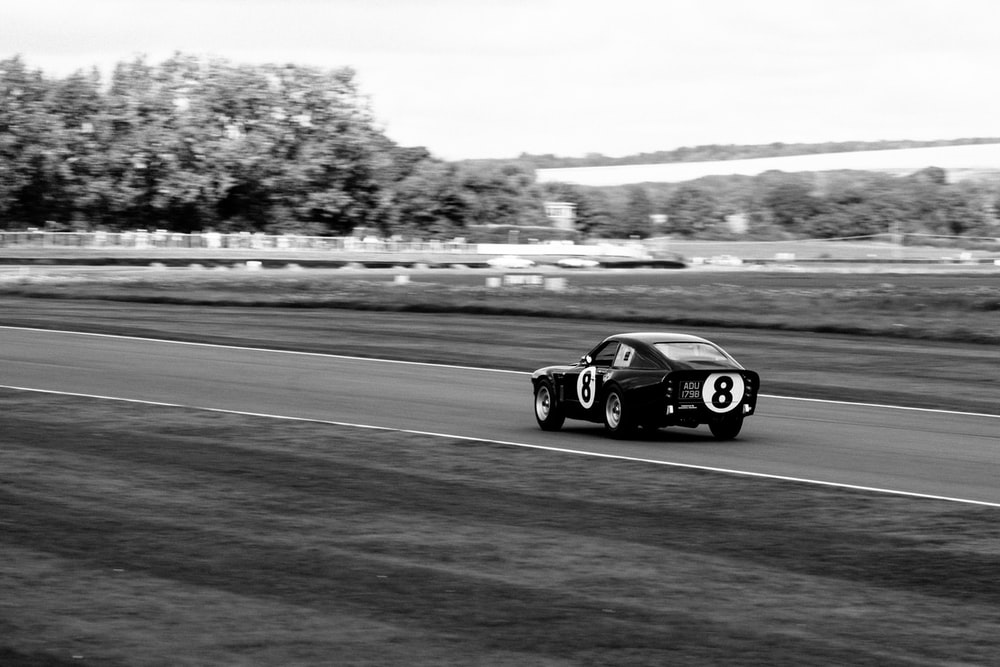 grayscale photography of racing coupe
