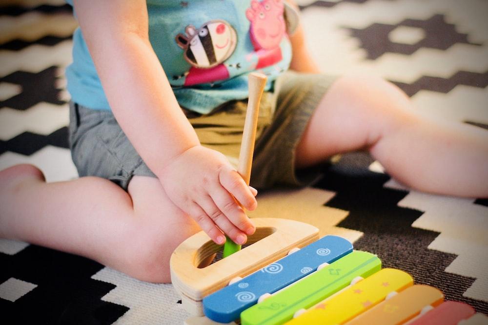child plating on carpet