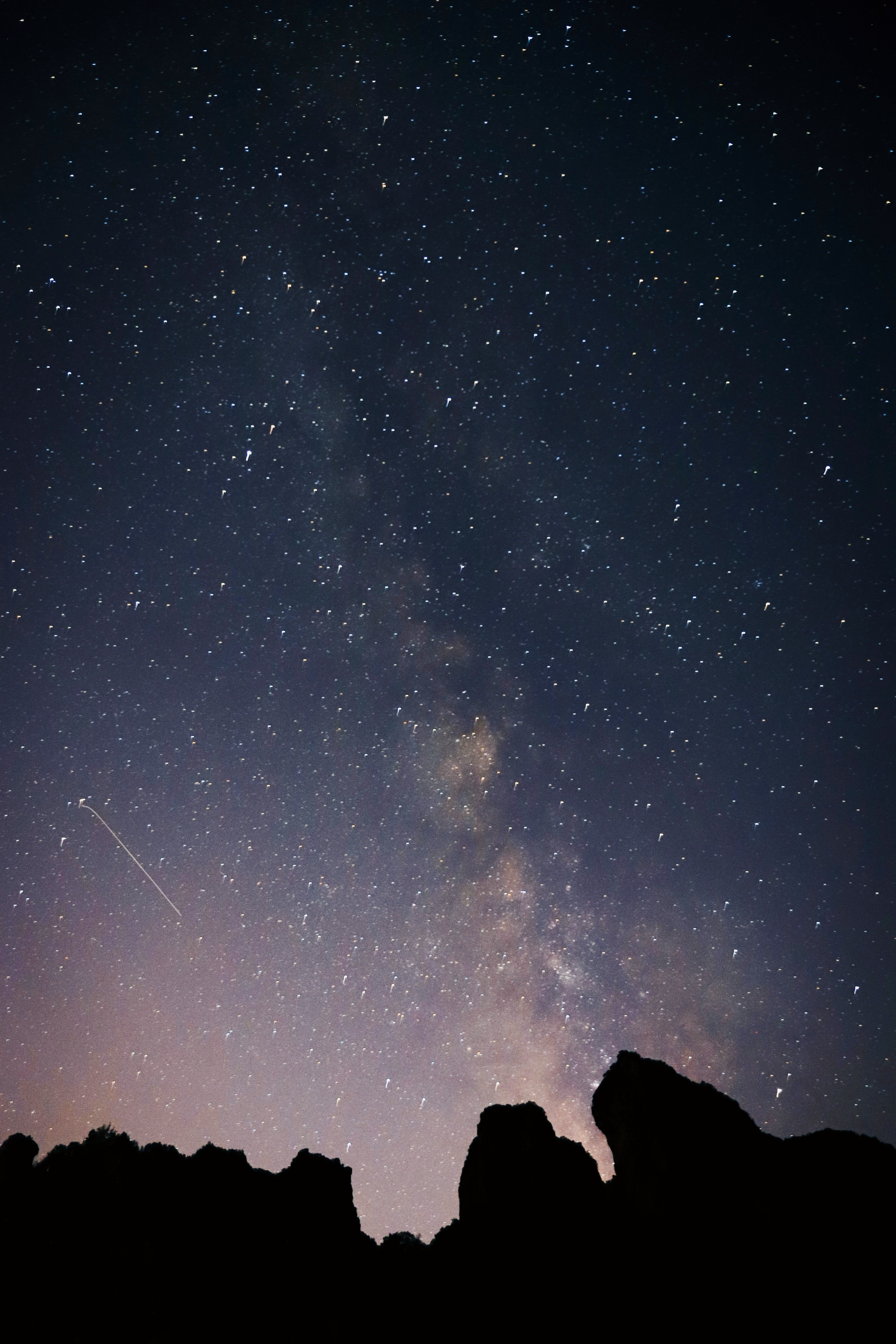 silhouette photo of mountains under starry night