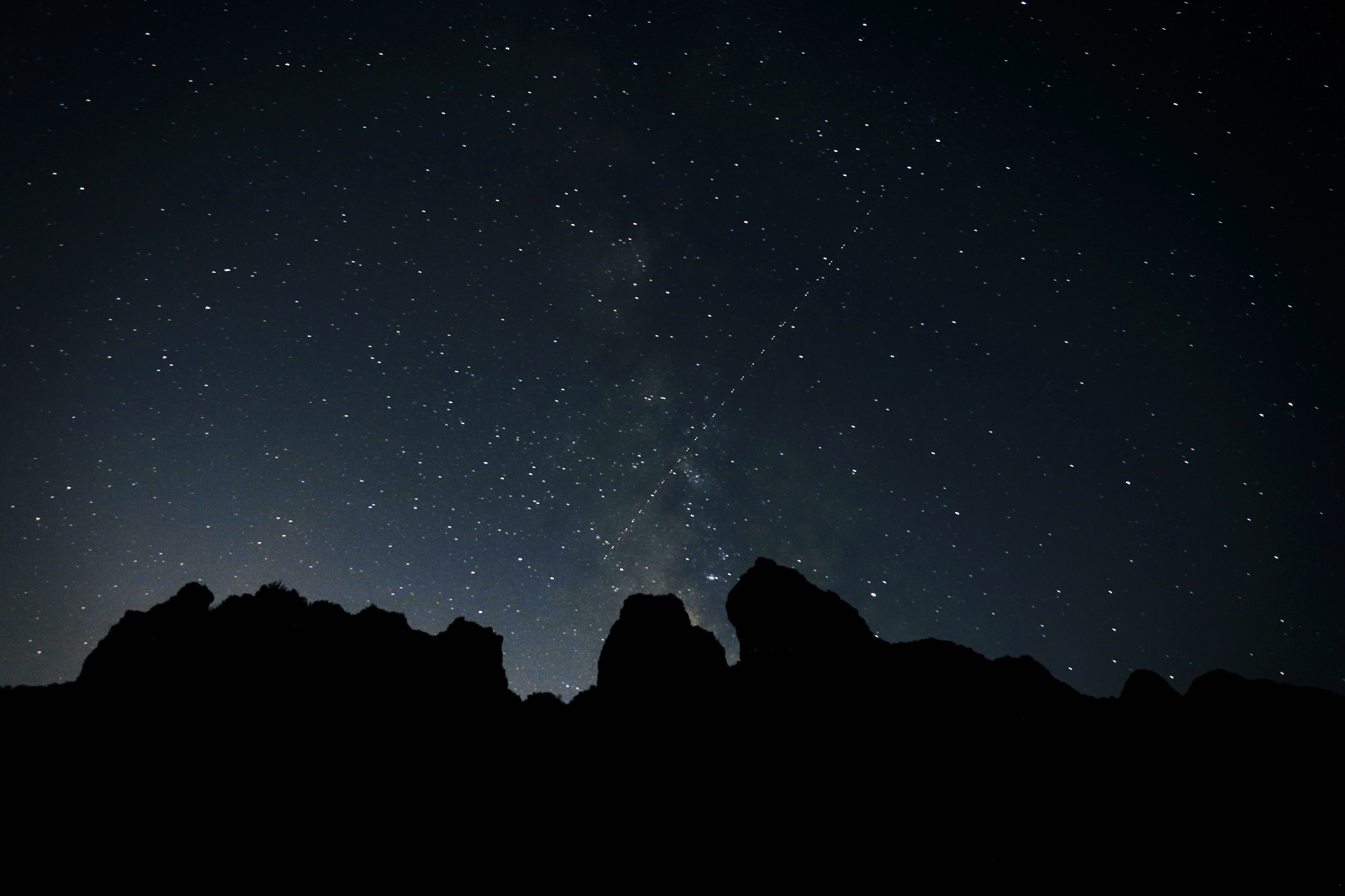 silhouette of mountain under milky way