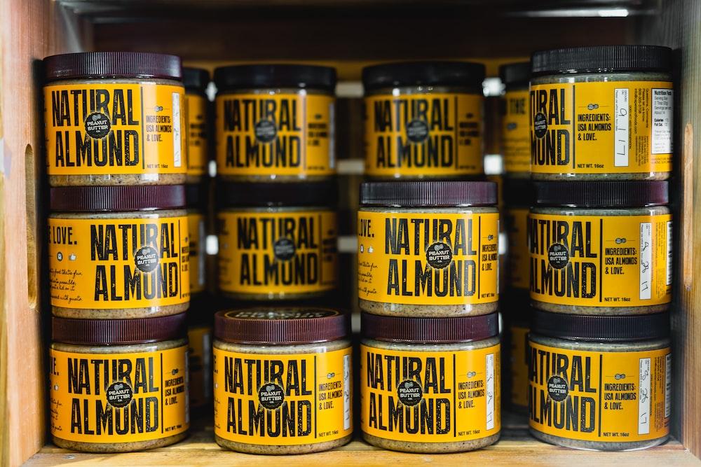 pile of Natural Almond bottles