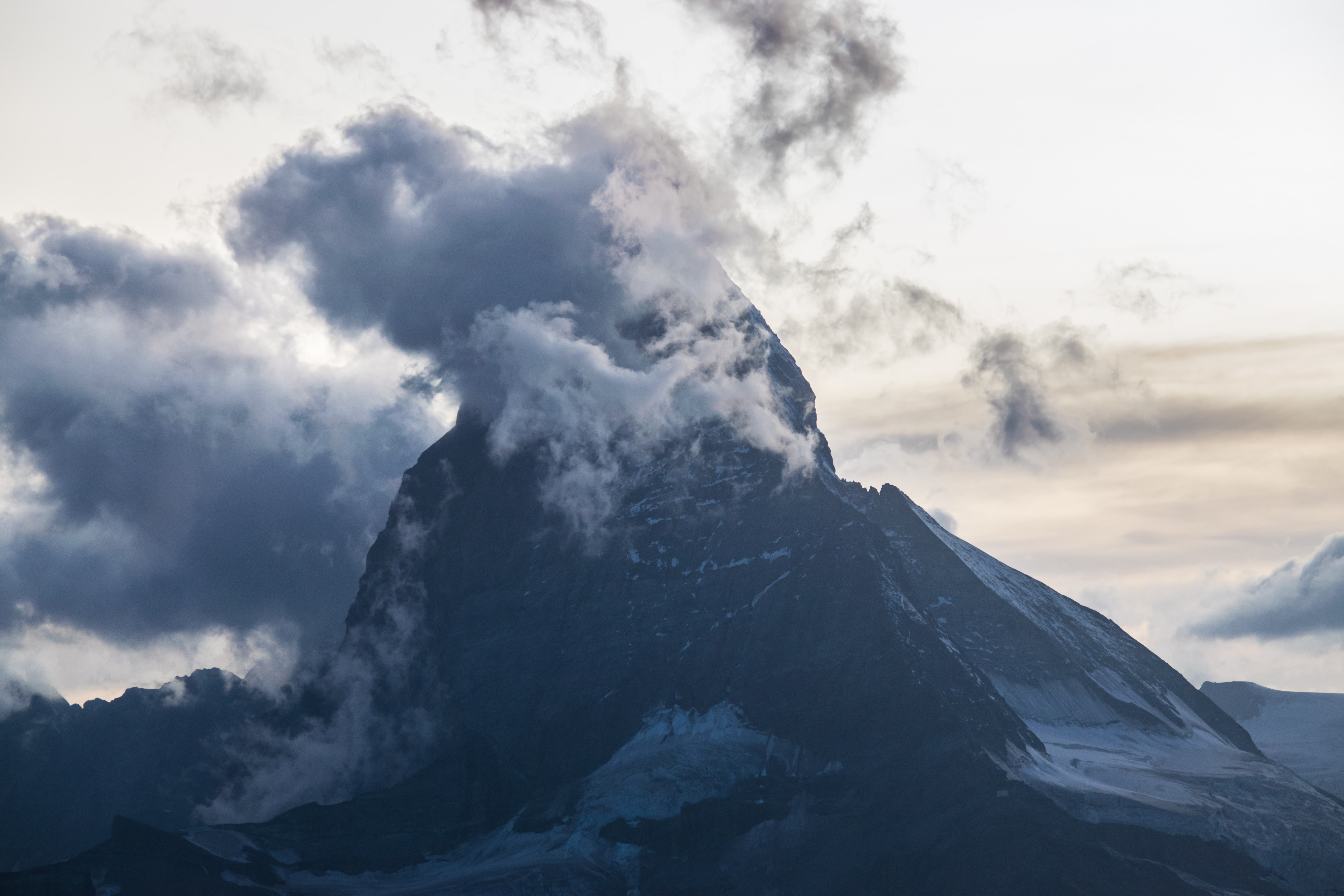 mountain near clouds during daytime