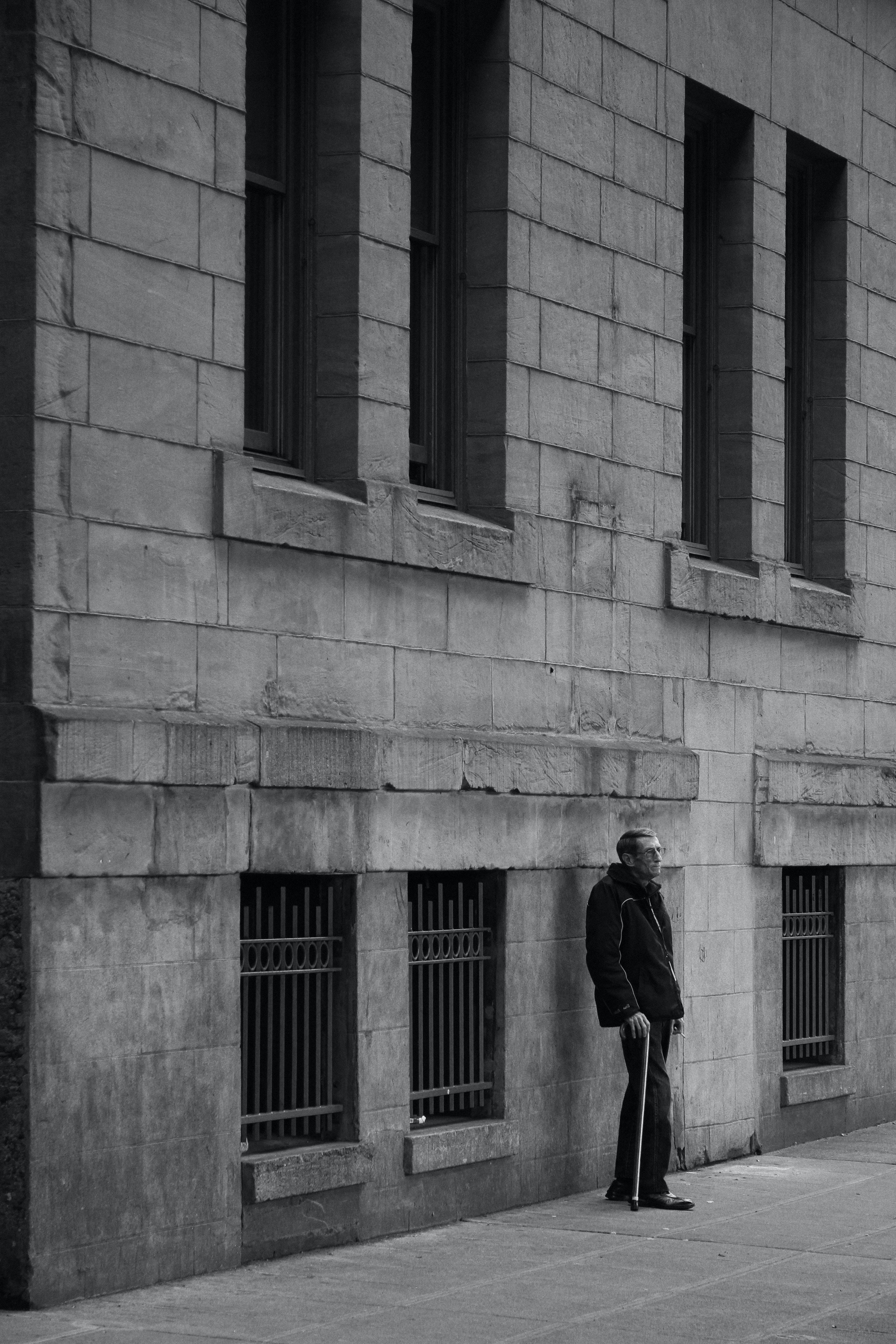 man standing near a wall