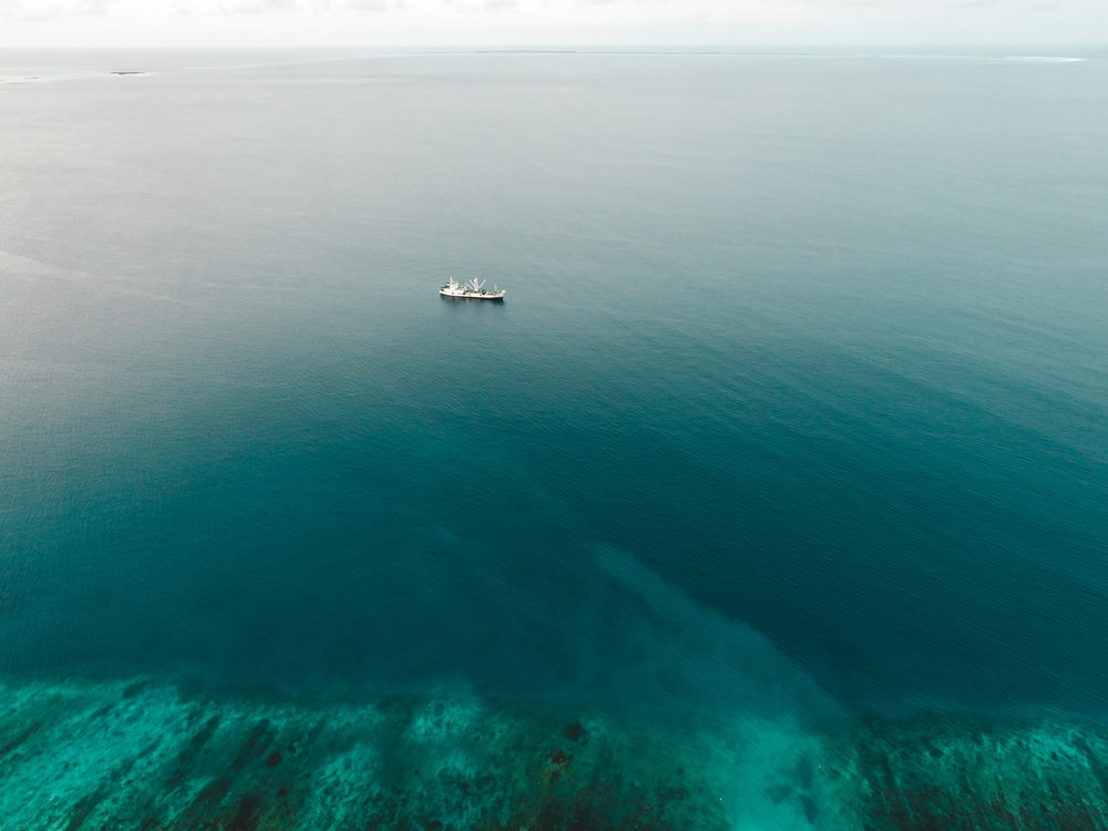 aerial photography of white boat on sea