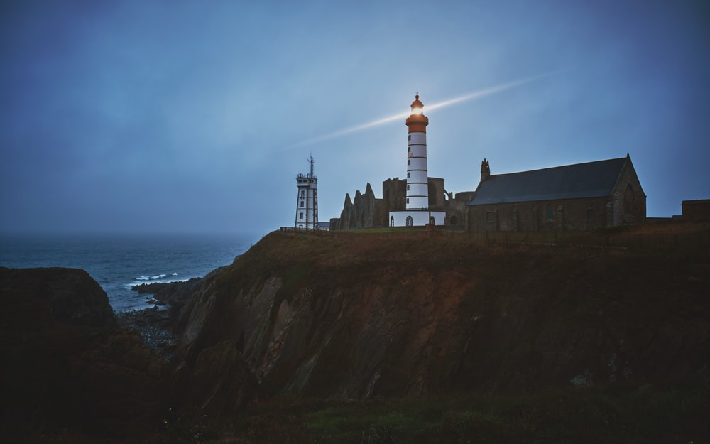 selective focus photography of white lighthouse
