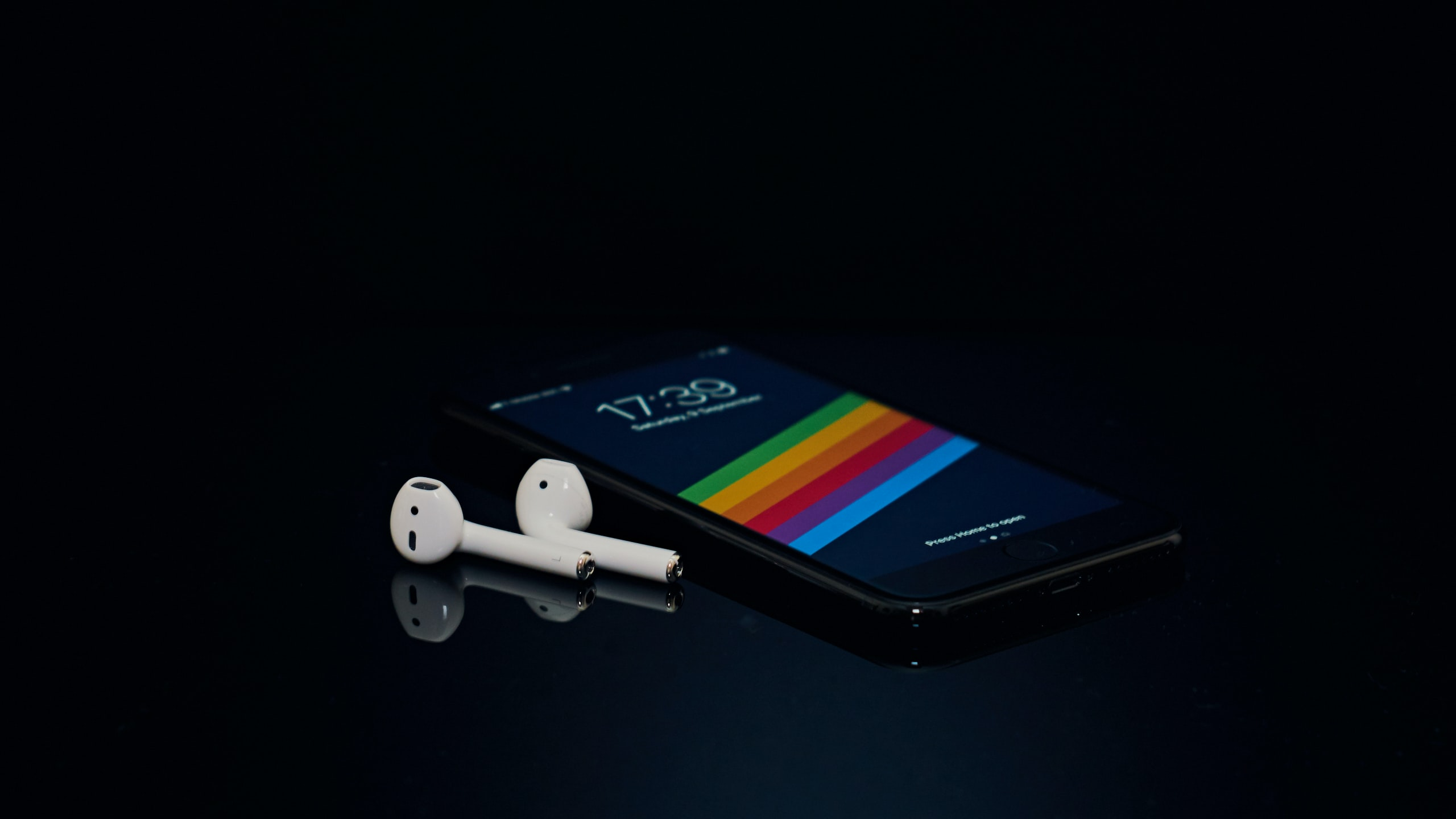 black Android smartphone and Apple AirPods