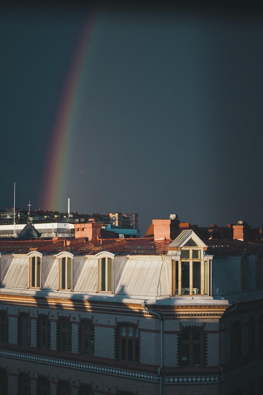 rainbow over buildings